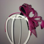 Purple fascinator on headband