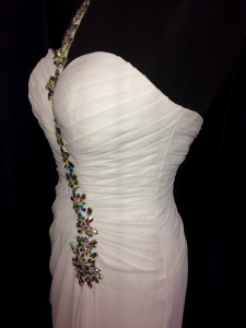 white ruched bodice with glittery over shoulder strap dress