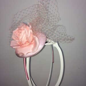 Pink rose fascinator on headband with birdcage netting